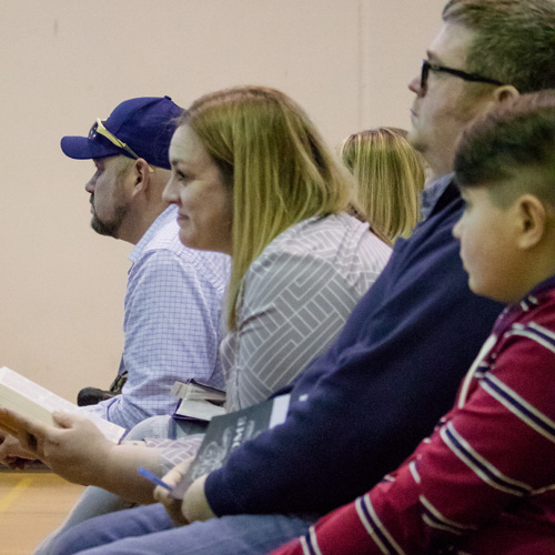 Listening intently during worship service